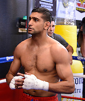 Dec 11,2012.  Montebello CA. USA.  Amir Khan works out for the press during a media day Tuesday afternoon at the Ponce De Leon Boxing Club.  Amir Khan will be fighting Carlos Molina this Saturday night at the Los Angeles Sports Arena live on ShowTime. .Photo By Gene Blevins/LA Daily News
