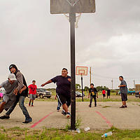 Area youth play a round of basketball during the Rock Springs Community Event at the Rock Springs Chapter House July 28.