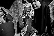 Mother and Sisters  of Adil (13)  that was executed by the Indian army after clashes in the village of Palhalan. The military led the way down the street from the hospital and executed him, 15 November, 2010.