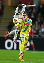 SWANSEA, WALES - Thursday, February 20, 2014: Swansea City's Ben Davies in action against SSC Napoli's Jose Callejon during the UEFA Europa League Round of 32 1st Leg match at the Liberty Stadium. (Pic by David Rawcliffe/Propaganda)