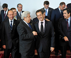 "Nicolas Sarkozy, France's president, right, shares a laugh with Dimitris Christofias, president of Cyprus, during the ""Family Photo"" session at the European Summit, in Brussels, Belgium, Wednesday, Oct. 15, 2008.   (Photo © Jock Fistick)"