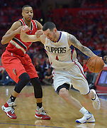 Los Angeles Clippers guard J.J. Redick #4 battles to get around Portland Trail Blazers guard C.J. McCollum #3 in the 4th quarter. The Portland Trail Blazers defeated the Los Angeles Clippers 108-98 in game 5 of the NBA Western Conference Playoffs first round. Los Angeles, CA.  April 27, 2016. (Photo by John McCoy/Southern California News Group)