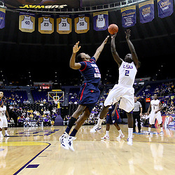 November 23, 2011; Baton Rouge, LA; LSU Tigers forward Johnny O'Bryant (2) shoots over South Alabama Jaguars forward Javier Carter (32) during the first half of a game at the Pete Maravich Assembly Center.  Mandatory Credit: Derick E. Hingle-US PRESSWIRE