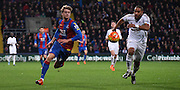 Patrick Bamford gives chase to the loose ball during the Barclays Premier League match between Crystal Palace and Swansea City at Selhurst Park, London, England on 28 December 2015. Photo by Michael Hulf.