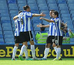 Lewis McGugan of Sheffield Wednesday celebrates his goal with team mates - Mandatory byline: Dougie Allward/JMP - 07966386802 - 08/08/2015 - FOOTBALL - Hillsborough Stadium -Sheffield,England - Sheffield Wednesday v Bristol City - Sky Bet Championship