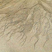 Sandstructures by the water on the beach, Iceland