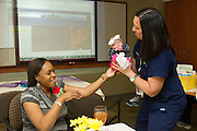 Mom Tranisha Misenheimer and daughter Zyan born at 33 weeks gestation returned to visit Nurse Manager Angela Carlson at Round Rock Medical Center Friday afternoon.  Hand to Hold and St. David's Medical Center sponsored a Mother's Day Brunch in honor of the NICU parents.