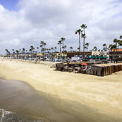Newport Beach California Oceanfront businesses with the Dory Fishing Fleet Market at 22nd Street.  Located on Balboa Peninsula by the Newport Pier, 22nd Street and Oceanfront Blvd is a popular destination in Orange County Southern California.