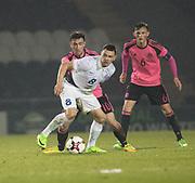 Estonia's German Slein holds off Scotland's Stephen Mallan - Scotland under 21s v Estonia international challenge match at St Mirren Park, St Mirren. Pic David Young<br />  <br /> - © David Young - www.davidyoungphoto.co.uk - email: davidyoungphoto@gmail.com