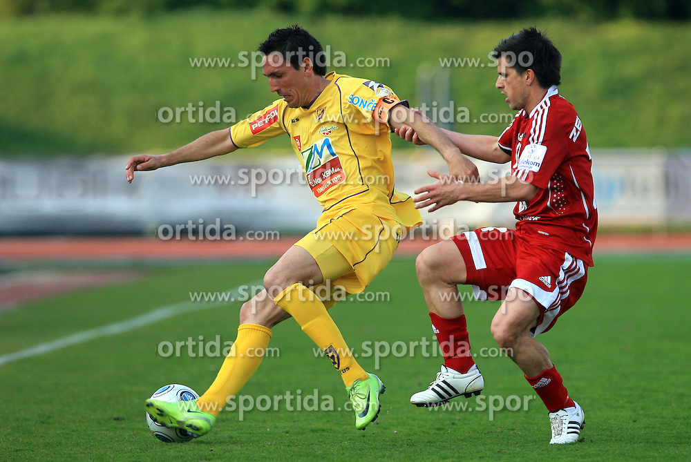 Zoran Pavlovic of Maribor vs Zoran Zeljkovic of Interblock at 1st semifinal match of Pokal Hervis between NK Interblock and NK Maribor at  ZAK Stadium, on April 15, 2009, in Ljubljana, Slovenia.  (Photo by Vid Ponikvar / Sportida)