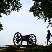 A visitor strolls by a cannon on Little Round Top, at Gettysburg National Military Park, on Sunday, June 30, 2013.  Little Round Top is the site of an unsuccessful Confederate assault that occurred on the second day of the Battle of Gettysburg, July 2, 1863.  The official Sesquicentennial Anniversary of the Battle of Gettysburg kicked off on Sunday, leading into a week full of demonstrations, reenactments and educational programs in and around Gettysburg, Pennsylvania.  A pivotal battle in the Civil War, over 50,000 soldiers died in the battle which spanned 3 days from July 1-3, 1863.  Later that year, President Abraham Lincoln returned to Gettysburg to deliver his now famous Gettysburg Address to dedicate the cemetery there for the Union soldiers who died in battle.  John Boal photography