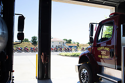 The peloton rides past a fire station during Stage 1 of the Amgen Tour of California - a 124 km road race, starting and finishing in Elk Grove on May 17, 2018, in California, United States. (Photo by Balint Hamvas/Velofocus.com)