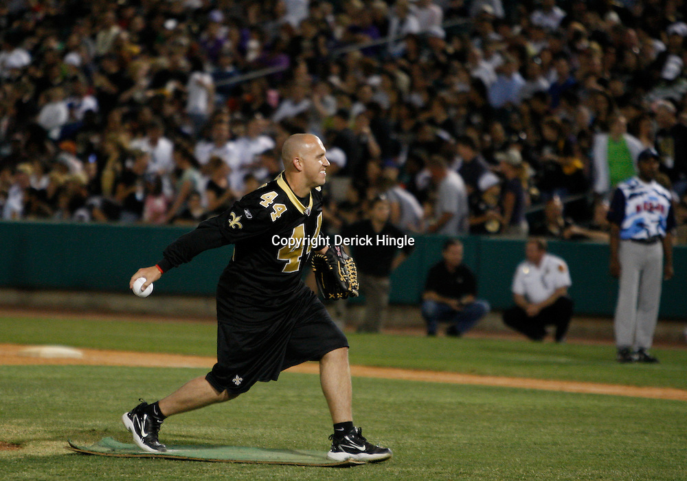 Apr 28, 2010; Metairie, LA, USA; Heath Evans (44) pitches the ball during the Heath Evans Foundation charity softball game featuring teammates of the Super Bowl XLIV Champion New Orleans Saints at Zephyrs Field.  Mandatory Credit: Derick E. Hingle-US-PRESSWIRE.