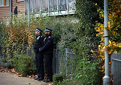 © Licenced to London News Pictures. 24/11/2013. London. UK.  <br /> General view of police officers standing guard outside 1C Peckford Place in Brixton, London, November 24th 2013. Two of three women who were allegedly held as slaves at the residence for at least 30 years met a man who has been arrested via a collective, police say.<br /> Photo Credit: Susannah Ireland