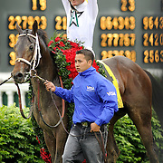 Calvin Borel celebrated his third Kentucky Derby win in four years, this time aboard Super Saver as they head to the winner's circle for the 136th the Kentucky Derby at Churchill Downs Saturday May 1, 2010. Photo by David Stephenson
