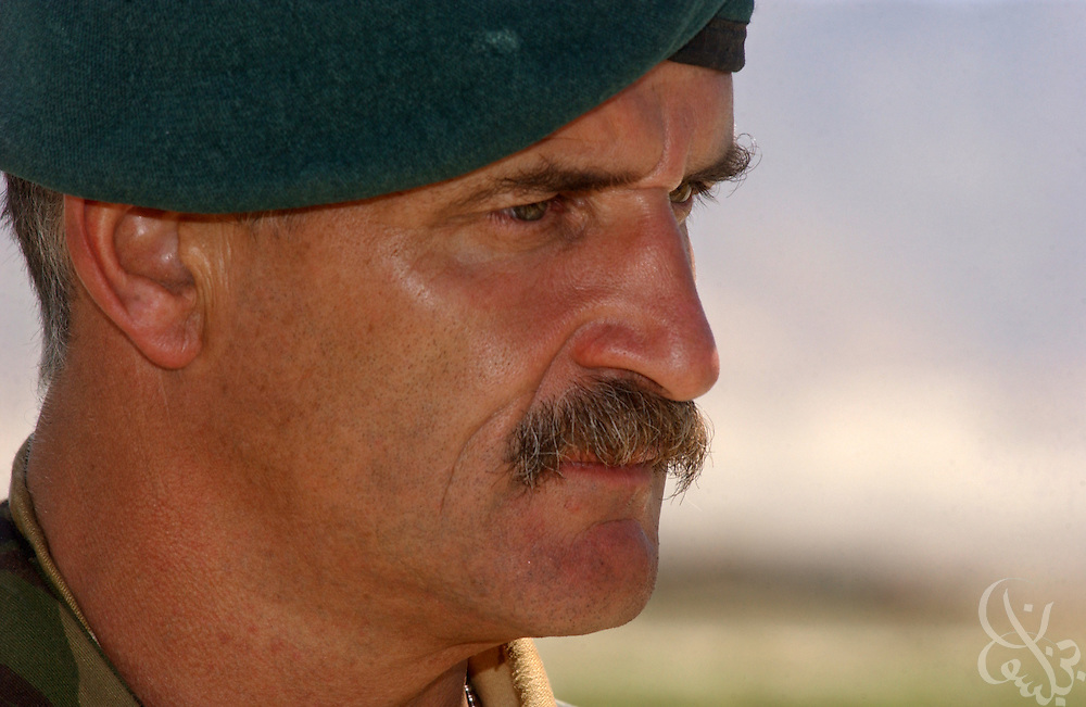 Brigadier Roger lane, commander of British Royal Marines 3 Commando Brigade in Afghanistan speaks with members of the press about his being replaced May 30, 2002 at Bagram airbase in Bagram, Afghanistan. Brigadier Lane has been replaced Brigadier Jim Dutton as commander of the unit after questions arose from critics regarding his leadership of the Royal marine force in Afghanistan.