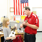 Rob McIntyre is the music teacher for the small community schools in Weston and Athena, northeast of Pendleton. He teaches instruments as diverse as the guitar, drums, ukelele and bagpipe to students to elementary, middle and high school students. Here, he works on a ukulele with Asha Waine at Weston Middle School.