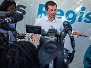 """13 AUGUST 2019 - DES MOINES, IOWA: PETE BUTTIGIEG answers reporters' questions at a """"press gaggle"""" at the Iowa State Fair. Buttigieg, the Mayor of South Bend, Indiana, is running to be the Democratic nominee for the US presidency. He spoke at the Des Moines Register Political Soap Box at the Iowa State Fair and then toured the fairgrounds. Iowa has the first event of the presidential selection cycle. The Iowa Caucuses are February 3, 2020.               PHOTO BY JACK KURTZ"""
