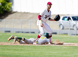 Kyle Botha of the Bothasig Knights dives back to first base after an attempted steal, while Kyle Ettisch, first baseman for the Bellviile Tygers, waits for the ball during the Major league game held at the Tygers' home ground at the PP Smit stadium in Bellville on 23 October 2016. Photo by John Tee/RealTime Images.