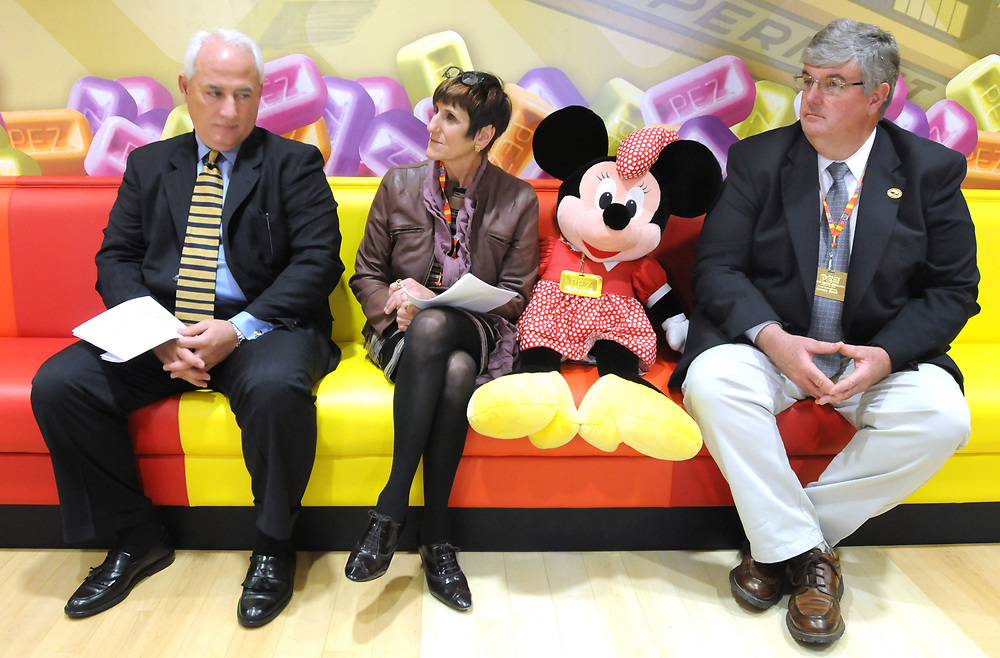 PEZ dedicated its new visitors center in Orange. At the event were left to right: PEZ president and CEO Joseph Vittoria, Congresswoman Rosa DeLauro, Disney's Minnie Mouse (PEZ has licensing with Disney) and Orange First Selectman James Zeoli. Photo by Mara Lavitt/New Haven Register<br /> <br /> 3/13/12