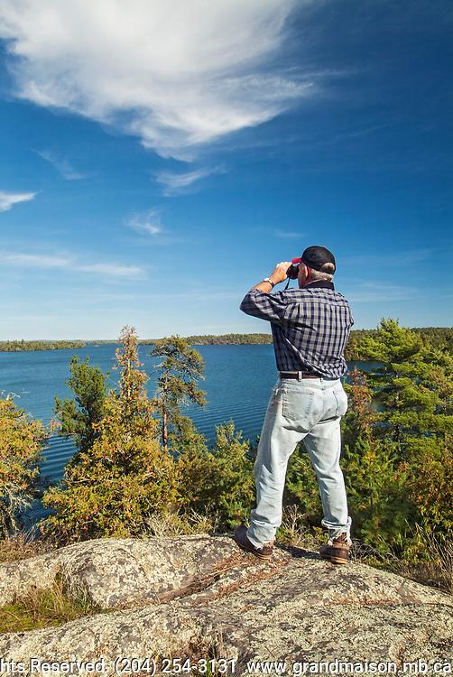 Hiker on Crow (Kakagi) Lake<br />Near Nestor Falls<br />Ontario<br />Canada