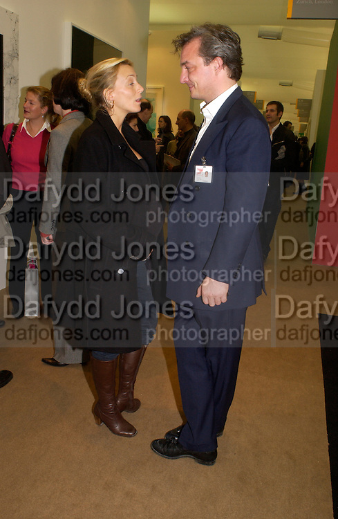 Phoebe Philo and Stefan Ratibar, Private view of the Frieze Art Fair, Regent's Park. 14 October 2004. ONE TIME USE ONLY - DO NOT ARCHIVE  © Copyright Photograph by Dafydd Jones 66 Stockwell Park Rd. London SW9 0DA Tel 020 7733 0108 www.dafjones.com