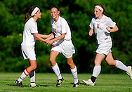 4 MAY 2010 -- ST. LOUIS -- Visitation Academy girls' soccer player Sandra Thorarensen (17, center ) is congratulated by her teammates after scoring what proved to be the game-winning goal during a game between Visitation and St. Dominic High School Tuesday, May 4, 2010 at Visitation in St. Louis. Visitation won the match, 2-1. Photo © copyright 2010 by Sid Hastings.