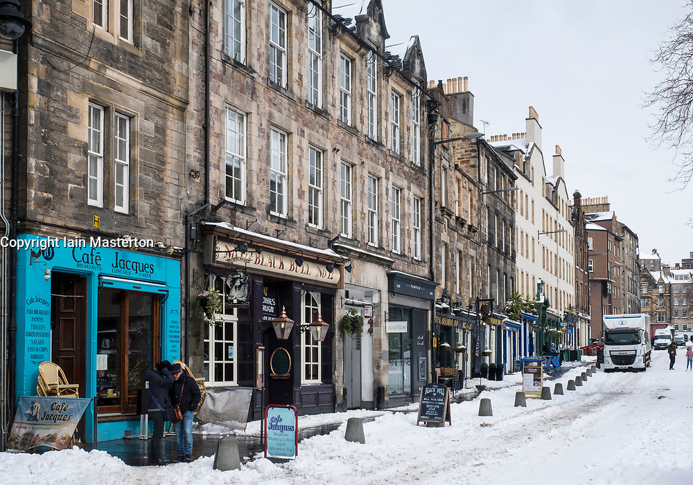 View of Grassmarket shops, bars and houses  during heavy snow fall in Edinburgh , Scotland, United Kingdom