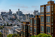 View of San Francisco apartments old and new with bell towers of Saints Peter and Paul Church shown in between.