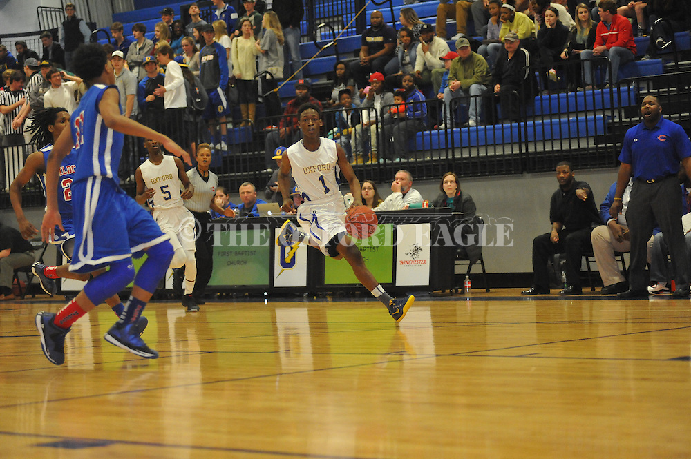 Oxford High's Jarkel joiner (1) vs. Clarksdale in MHSAA Class 5A boys basketball in Oxford, Miss. on Saturday, February 28, 2015.  Oxford won 76-57 to improve to 26-4.