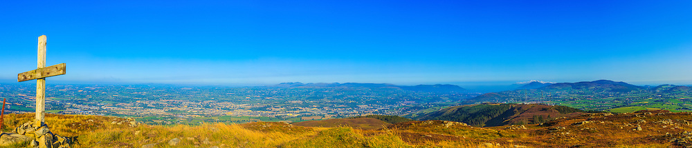 A nice sunny one from the summit of Camlough Mountain back at the start of October on a hazy day, overlooking Newry, the Mourne Mountains, Carlingford Lough and the Cooley Peninsula.<br /> <br /> Image composed of 9 photos at 35mm in portrait orientation.<br /> <br /> Available in sizes ranging from 8&quot;x36&quot; - 20&quot;x90&quot; (20cmx91cm - 51cmx229cm)