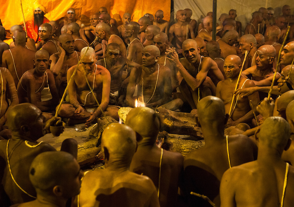 Young men becoming Naga Sadhu, Maha Kumbh Mela festival, world's largest congregation of religious pilgrims. Allahabad, India.