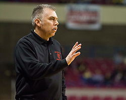 Sissonville head coach Rich Skeen speaks to his players against Clay County during a first round game at the Charleston Civic Center.