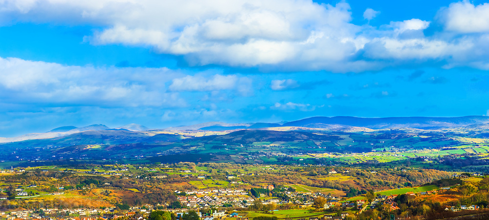View overlooking the Mourne Mountains and Newry from Bernish viewpoint on a sunny, hazy day.<br />