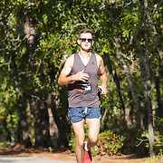 Photos of runners competing in the US Road Running Halyburton Park 2 Person Half Marathon Saturday September 21, 2019 at Halyburton Park in Wilmington, N.C.