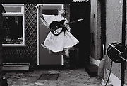 Teenager jumping with guitar, London, UK, 1983