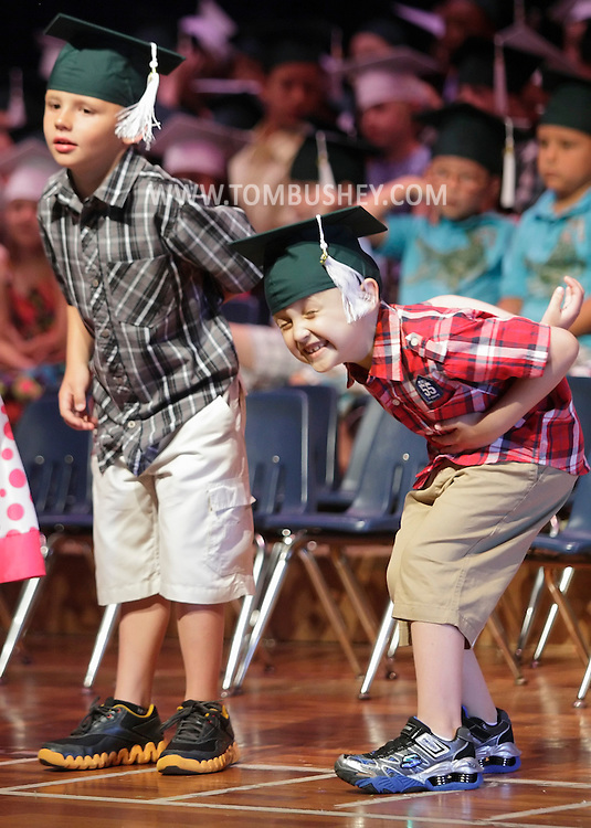 Michael Zechewytz, right, and Andrew Woznick takes their bows during kindergarten graduation at Minisink Valley Elementary School in Slate Hill on Tuesday, June 19, 2012. About 700 people filled the auditorium to watch 167 students from eight classses graduate.