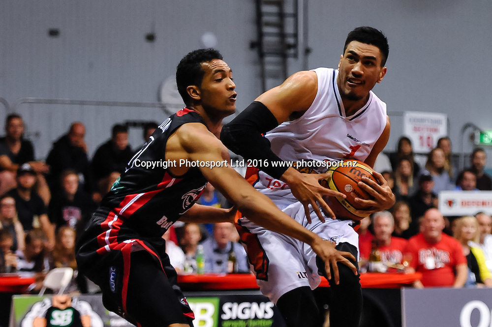 Ana Haku of the Southland Sharks trys to get past Marcel Jones of the Rams during the NBL Basketball Match, Canterbury Rams V Southland Sharks, Cowles Stadium, Christchurch, New Zealand. 25th March 2016. Copyright Photo: John Davidson / www.photosport.nz