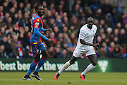 Crystal Palace forward Emmanuel Adebayor  and Liverpool defender Mamadou Sakho (17)  during the Barclays Premier League match between Crystal Palace and Liverpool at Selhurst Park, London, England on 6 March 2016. Photo by Simon Davies.