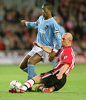Sylvain Distin (City) Chris Marsden (Southampton). Southampton v Manchester City. 1/11/2003. Credit : Colorsport/Andrew Cowie.