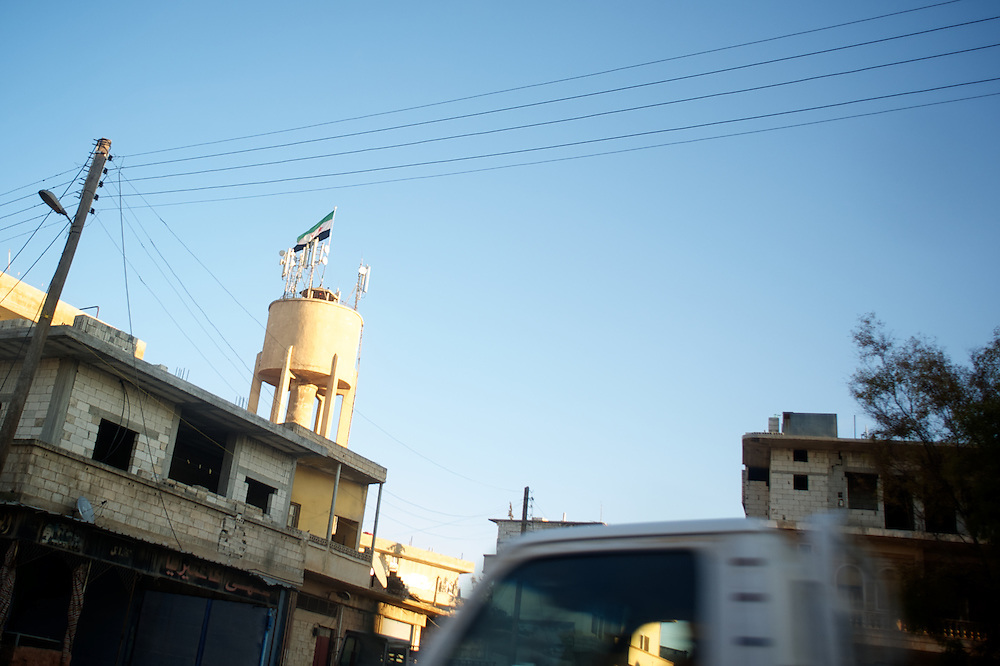 January 20, 2012 - Idleb, Syria: A Syrian revolutionary flag is displayed in a water tower in central Bennish.
