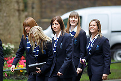 © licensed to London News Pictures. London, UK 25/02/2014. Women's Curling team visiting Downing Street to meet Prime minister David Cameron on Tuesday, 25 February 2014 after their success in the Sochi 2014 Winter Olympics. Photo credit: Tolga Akmen/LNP