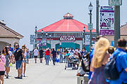 Tourists Walking on the Huntington Beach Pier in August