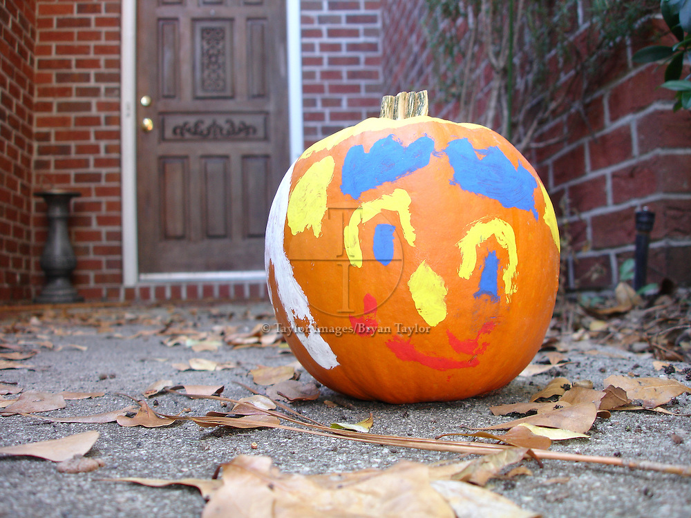 Halloween pumpkin with painted face.