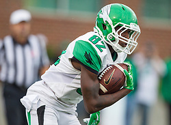 Oct 24, 2015; Huntington, WV, USA; North Texas Mean Green wide receiver D'Aundrey Bradley returns a kickoff during the first quarter against the Marshall Thundering Herd at Joan C. Edwards Stadium. Mandatory Credit: Ben Queen-USA TODAY Sports