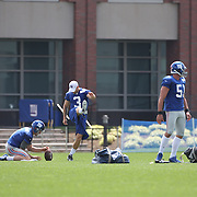Kicking team Steve Weatherford (left), Zac DeOssie, (right) and Josh Brown, practicing kicking timing during the 2013 New York Giants Training Camp at the Quest Diagnostics Training Centre, East Rutherford, New Jersey, USA. 29th July 2013. Photo Tim Clayton.