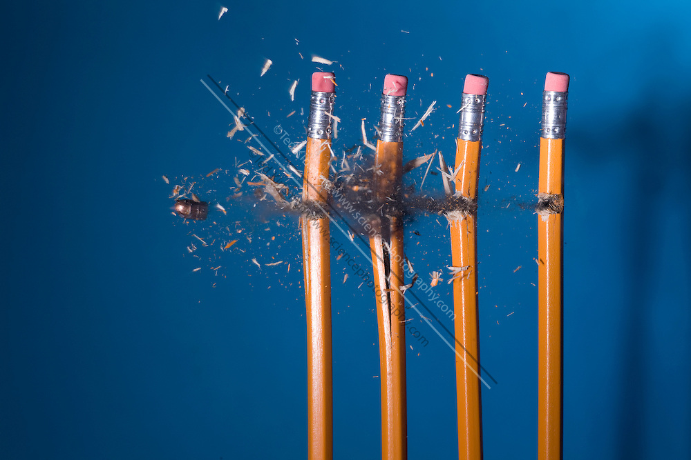 A .22 caliber bullet hitting four pencils.  The bullet is traveling at 660 feet per second (201.2 meters per second). This image shows the collision of the bullet and pencil photographed at  1/1,000,000th of a second.