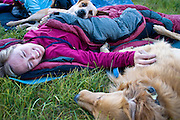 Katie Cavicchio and her two dogs curl up together while sleeping outside in Utah's Uinta Mountains.