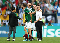 Mexico's Andres Guardado celebrates with Mexico Manager Juan Carlos Osorio after the final whistle