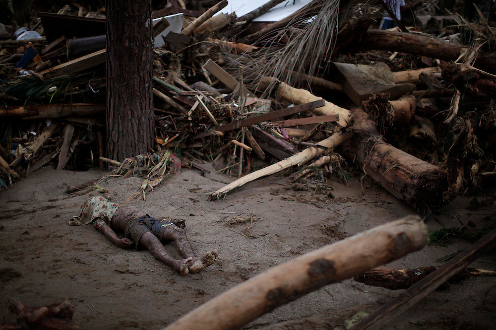 A landslide victim is lays next to debris in Teresopolis, Brazil, Thursday, Jan. 13, 2011.<br /> <br /> A series of flash floods and mudslides struck several cities in Rio de Janeiro State, destroying houses, roads and more. More than 900 people are reported to have been killed and over 300 remain missing in this, Brazil&rsquo;s worst-ever natural disaster.